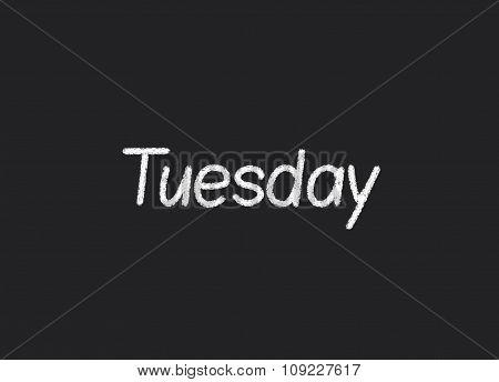 Tuesday written on a blackboard