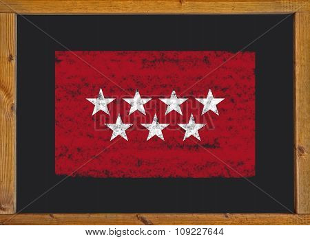 The flag of the autonomous community of Madrid on a blackboard