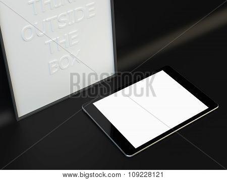 tablet on black background