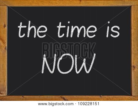 The time is now written on a blackboard