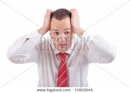 Strongly Afflicted Business Man, With Hands On Head, Isolated On White