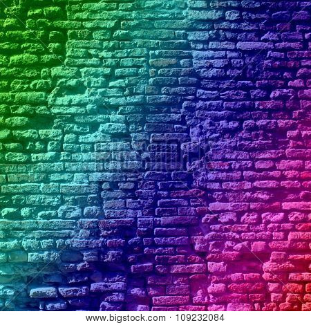Concept or conceptual colorful painted or old vintage grungy brick wall texture or urban background