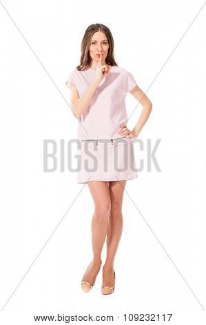 Young slim pretty woman in pink dress posing isolated on white background