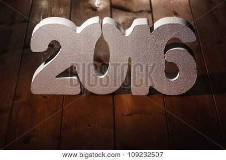 number 2016 on wooden table background