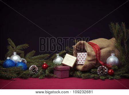 Christmas background with jute sack and gift boxes