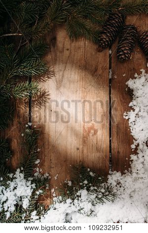 fir cones and branches on wooden background