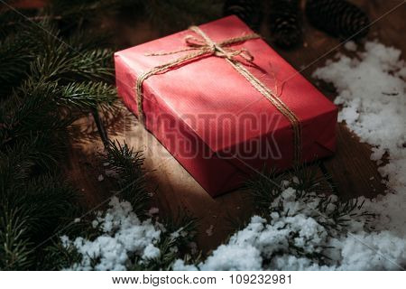 gift box and fur tree on wooden background