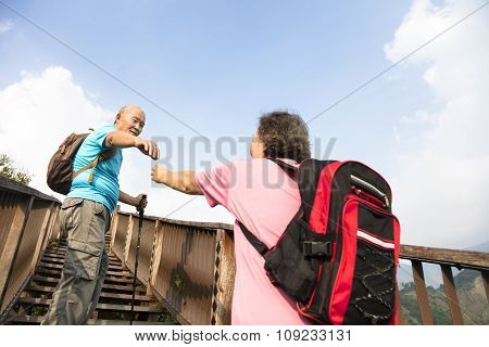 Helping Hand Between Happy Senior Couple