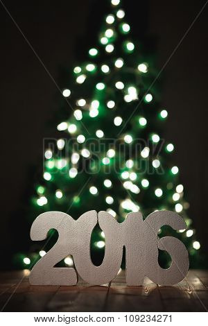 number 2016 on wooden table background, new year template