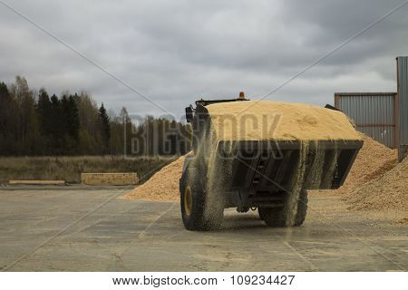 Auto Loader With Scoop Full Of Sawdust