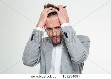 Portrait of a stressed businessman looking at camera isolated on a white background