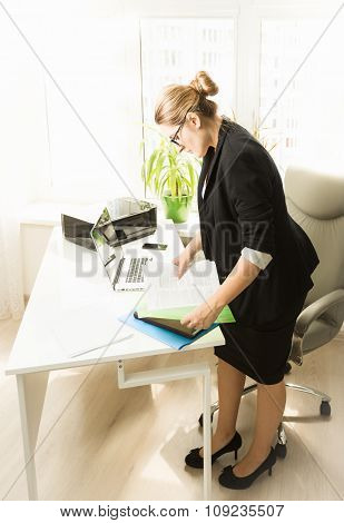 Young Businesswoman Working With Papers At Office
