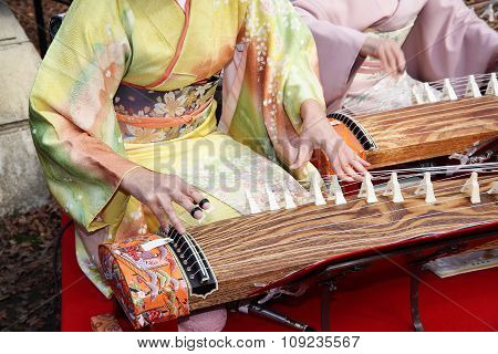 Japanese woman playing the traditional instrument