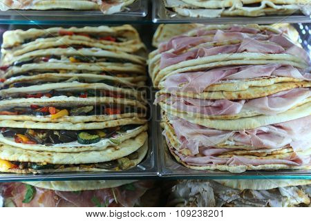 Appetizing Piadina Stuffed For Sale In The Restaurant In Central Italy