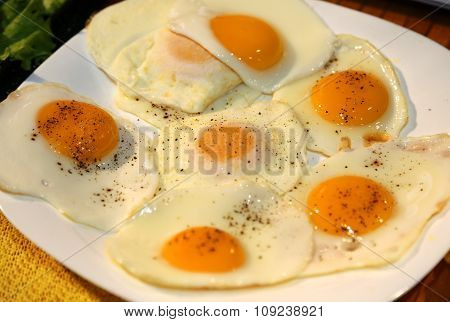 Fried Eggs Topped With A Little 'spice And Pepper During The Breakfast At The Restaurant