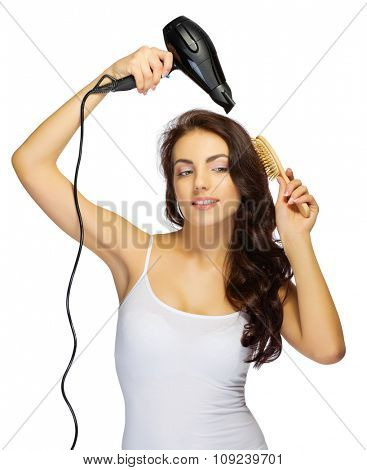 Young girl with hair dryer and brush isolated