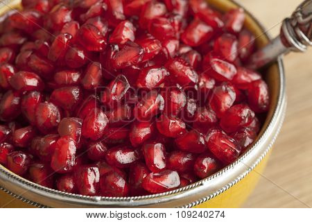 Moroccan dessert from fresh red pomegranate seeds close up
