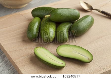 Fresh whole and half cocktail avocado's