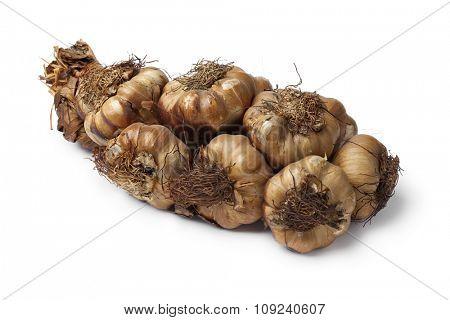 Smoked garlic braid on white background