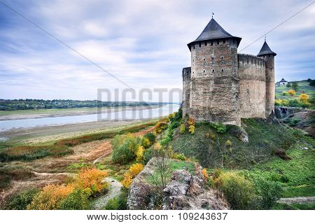 Mysterious castle on river bank