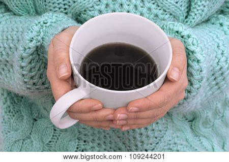 Close Up Of Woman Hands Holding Cup Of Coffee