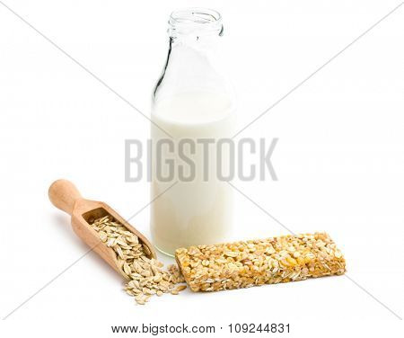 muesli bar and milk in glass bottle