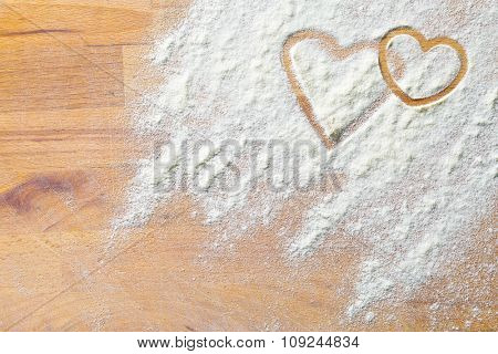 hearts of flour on a wooden table