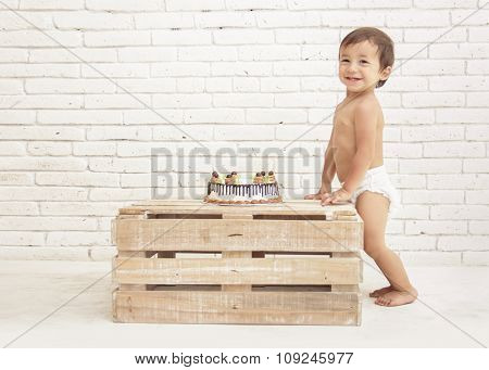 Adorable Toddler Smiling With Cake On Wooden Box
