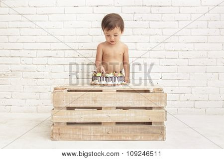 Handsome Toddler Playing With His Cake
