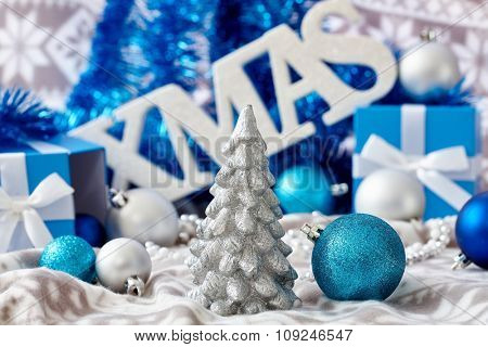 Christmas decoration with ornaments and letters xmas in blue.