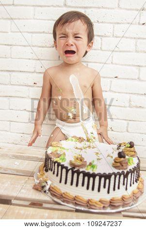 Adorable Toddler Crying While Playing Smash Cake
