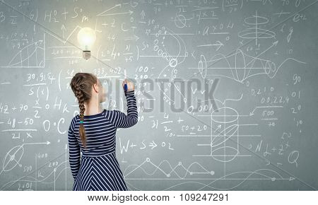 Cute girl of school age and blackboard on background