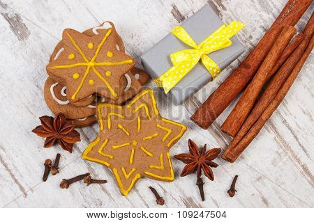 Gingerbread With Spices And Gifts For Christmas On Old Wooden Background, Christmas Time