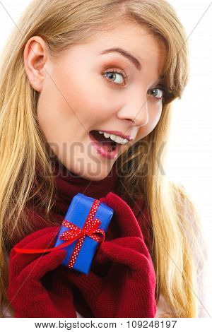 Smiling Woman In Woolen Gloves With Wrapped Gift For Christmas Or Other Celebration