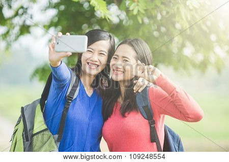 Two Young Asian Students Taking Selfie, Happily