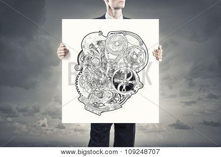 Unrecognizable businessman showing banner with gears mechanism concept