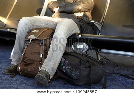 Man  Waiting Airport Terminal. Man  Sitting At Chairs Waiting Lounge Airport Building
