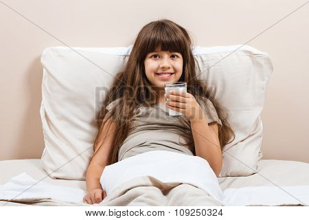 Glass of milk for beautiful little girl