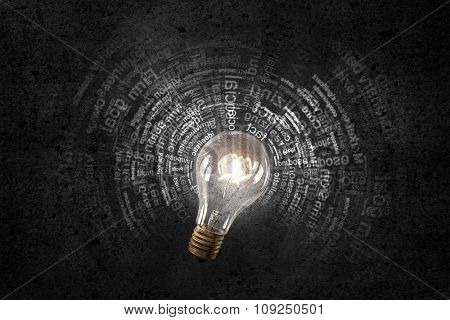 Glowing glass light bulb and busines concepts on background