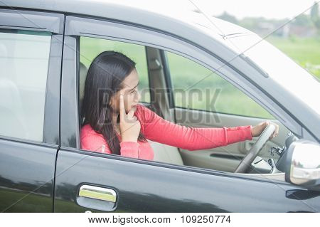 Young Asian Woman Looks Stress While Driving Her Car