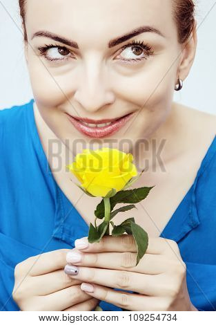 Young Lovely Caucasian Woman Sniff Yellow Rose