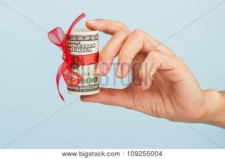 Woman Hand With Money On The Blue Background