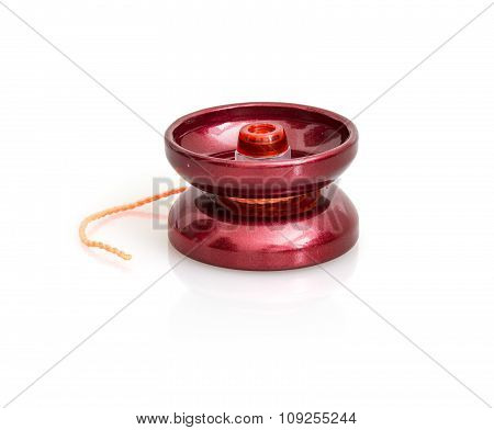 Red Yoyo With Twine On The White Background