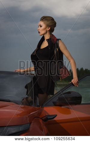 Fashion Woman Standing Near Vehicle With Opened Door