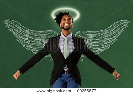 African American businessman hero with wings and halo over green surface
