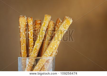 Bread Sticks With Cheese And Sesame In The Glass, Close Up