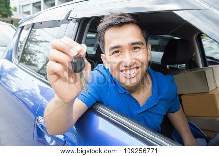 Asian Man Driver Smiling And Showing Car Key