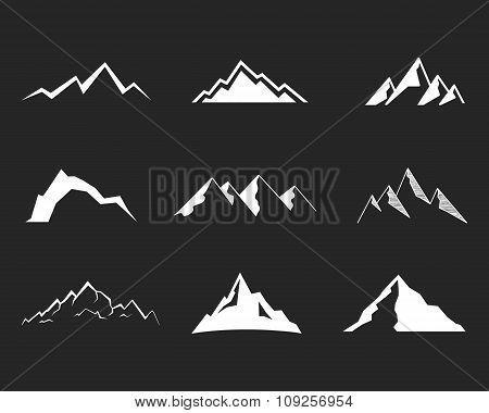 Set of mountain silhouette elements. Outdoor icon. Hand drawn snow ice mountain tops, decorative sym