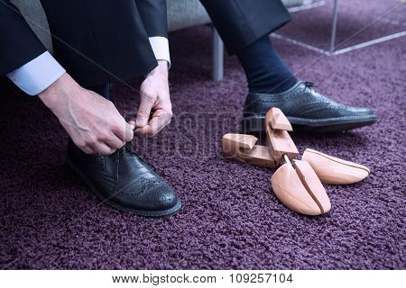 Businessman Putting His Shoes On