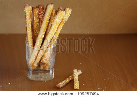Bread Sticks With Cheese And Sesame In The Glass